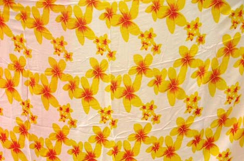 Sarong distribution company imports quality Daisy type floral pattern on beach cover up
