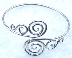 Lady's jewelry wholesale supply 925. sterling silver bangle with 2 spiral and curvy line design in the middle