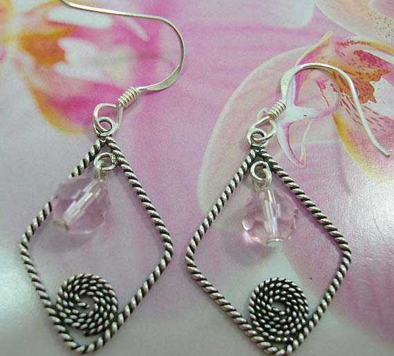 Twisted sterling silver open diamond shape French fish hook earwires  earring hanging a pink crystal and spiral pattern in the middle