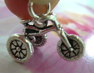 925. Thailand made solid sterling silver charm pendant in carved-out traditional 3-wheel bicycle design