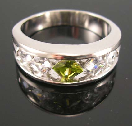 Online cz jewelry wholesale supply cz ring with lime green cz lie in center paired with two clear cz stones