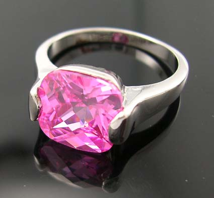 Exclusive price for holiday jewelry shopping wholesale in rhodium plated ring with pink cz in central design