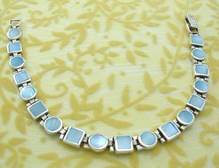 Sterling silver fashion pearl jewelry in bracelet with multi square adn rounded shape with blue mother of pearl inlay